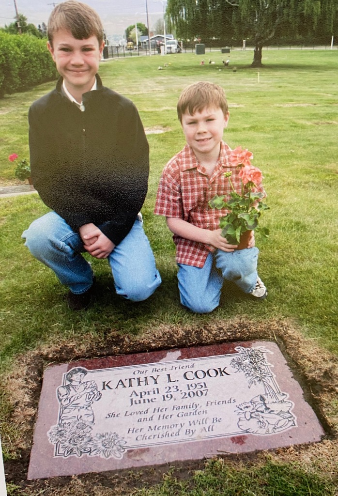 Riley and Dylan at Grama Kath's grave